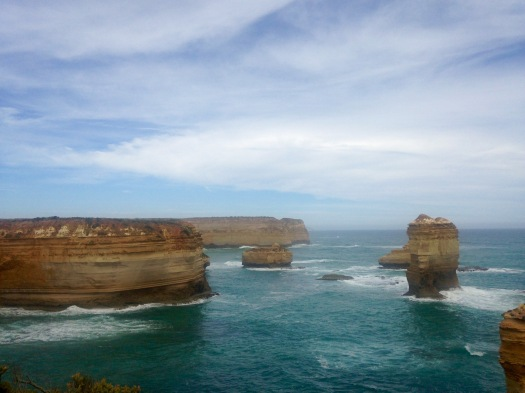 Sandstone pillars stick out amongst the blue ocean on the Great Ocean Road