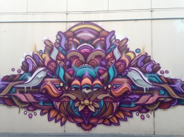 Abstract purple Street Art design graffitied on wall in Taupo, New Zealand