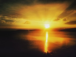 A bright yellow sunset over the lake at Taupo