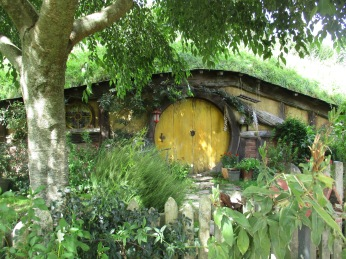 The famous round door of a Hobbit home in the Hobbiton movie set tour in New Zealand