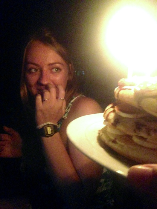 """Girl smiles as she is presented with birthday """"cake"""" pancakes"""