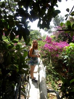 Posing for a photo while exploring the rooftop bridge gardens