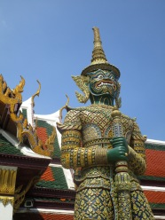 Intricate statue stands tall and intimidating over tourists