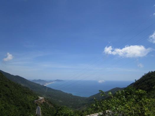 Coastal mountains with lush greenery alongside blue ocean waters in Vietnam