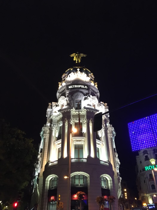 The illuminated Metropolis Building at night in Madrid