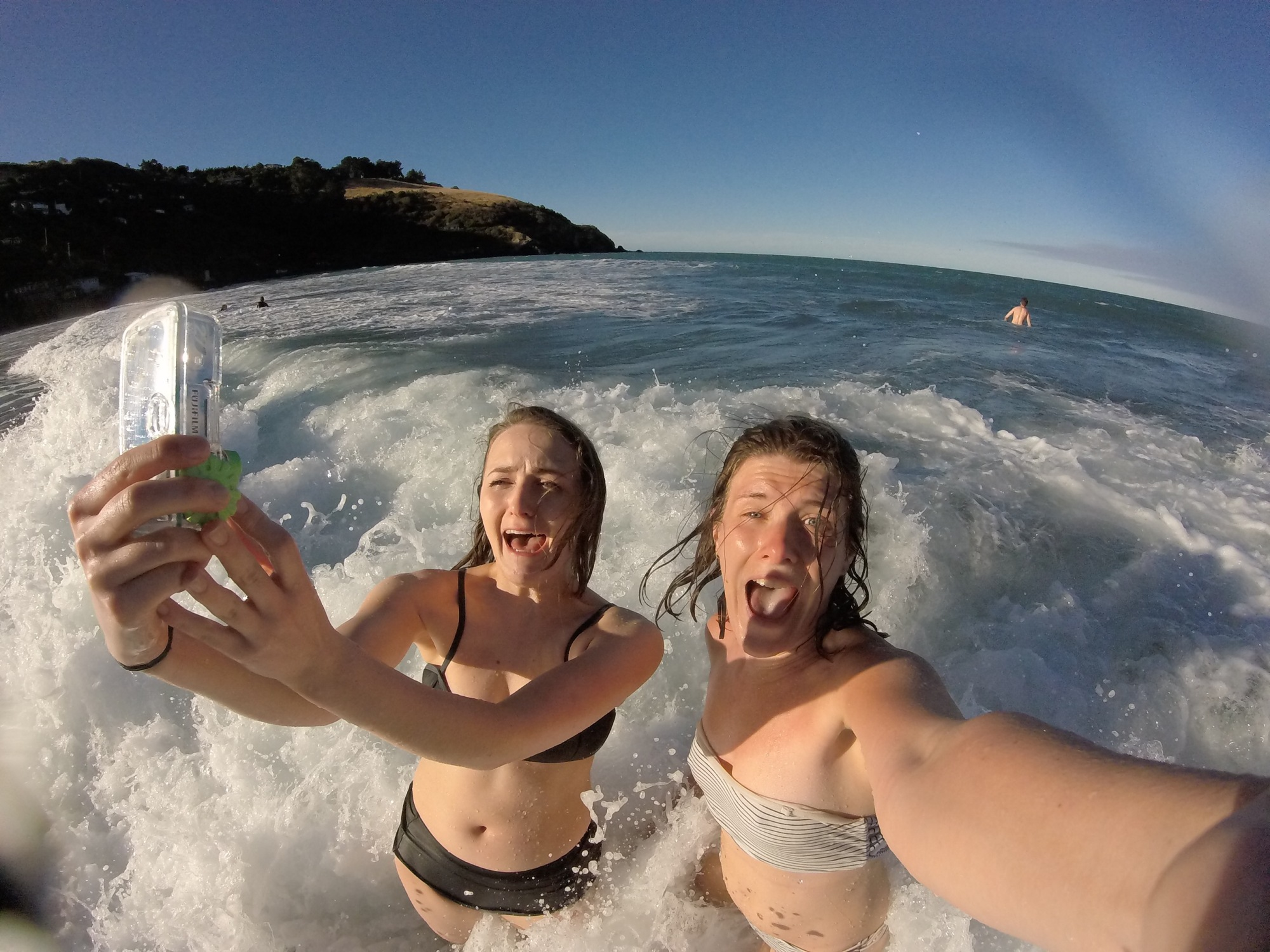 GoPro image on a sunny beach day in Christchurch New Zealand just as a wave hits