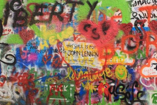Graffiti quotes written on John Lennon Wall in Prague
