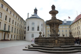 The outer square of Prague Castle with fountain and chapel