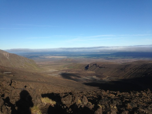 Horizon view of mountains covered in cloud in the distance overlooking the Tongariro Alpine Crossing