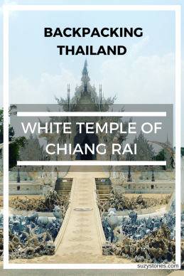 Text overlay the White Temple in Chiang Rai